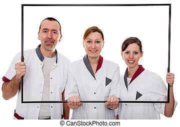 nurses are looking through a frame