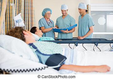 Nurses Examining Patient's Report