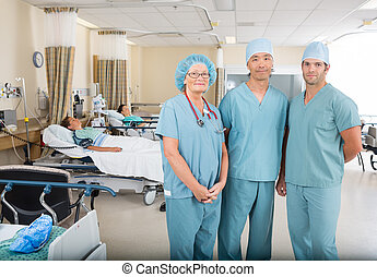 Portrait of multiethnic nurses standing in hospital ward