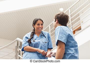 Nurses talking on stairs