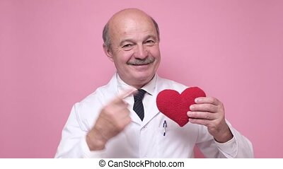 Senior man use hands to show heart shape concept.
