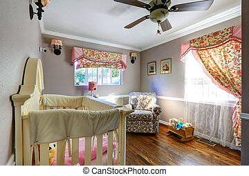 Nurshery room interion with floral curtains