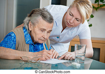 nursing home - Assisting a senior woman by nurse at home