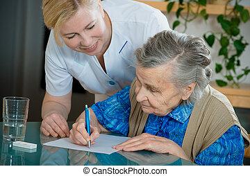 nursing home - Assisting a senior woman by nurse at home