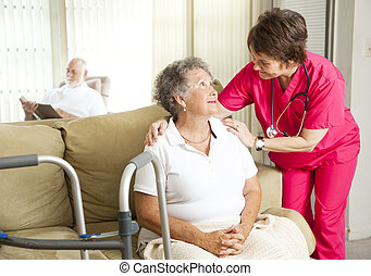 Senior woman in a nursing home, with a caring nurse.