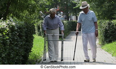 Disabled patients of a nursing-home taking a walk together