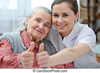 Nursing home - Senior woman and female nurse are showing ...