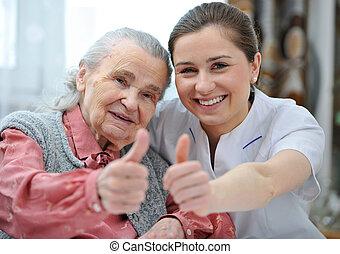 Nursing home - Senior woman and female nurse are showing...