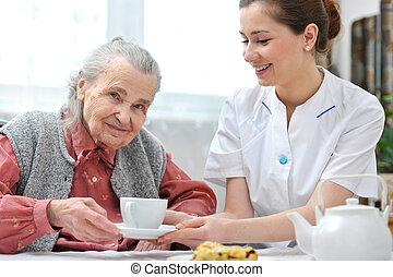 Nursing home - Senior woman eats lunch at retirement home