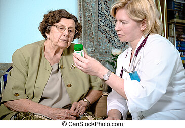 nursing home - Senior woman is visited by her doctor or ...
