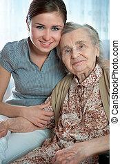 nursing home - Senior woman with her home caregiver
