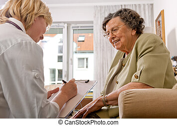 nursing home - Senior woman is visited by her doctor or...