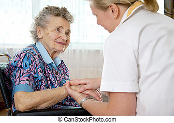 Nursing home - Senior woman with her home caregiver.