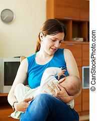 Nursing seven-month baby