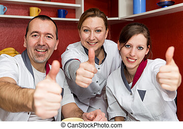 nursing staff lifting thumbs up - nursing staff points to...