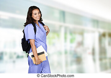 Nursing Student - Female nurse who is studying for her job