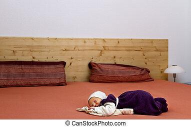 nursling alone in huge bed