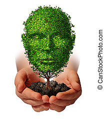 Nurture growth?life development concept with a hand holding a green tree shaped as a front view human head as a caring metaphor and nature symbol for protection of the environment and growing potential.