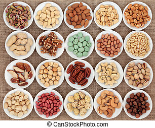 Nut Selection - Large nut selection in white porcelain bowls...
