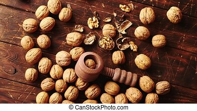 Nutcracker and nuts lying on table - From above shot of...