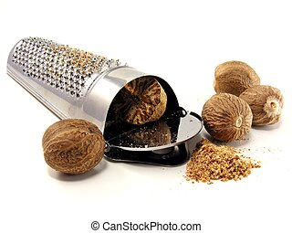 Selection of nutmeg with grater on white background