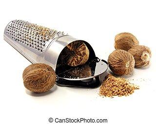Nutmeg & grater - Selection of nutmeg with grater on white ...