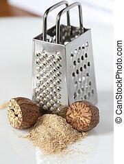 Nutmeg. - Nutmeg grated on a grater. Making nutmeg powder...
