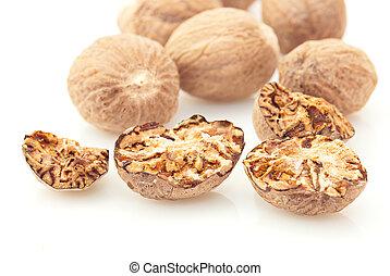 Nutmeg spice over white background