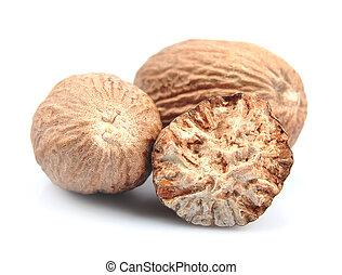 Nutmeg closeup on white.