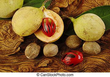 nutmeg fruits on wooden background