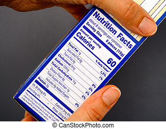 Nutrition facts on food box in person hands