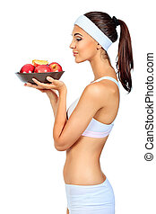 nutrition - Portrait of a beautiful young woman with fruits....
