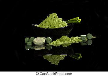 Spirulina, chlorella, wheatgrass, barleygrass pills, ground powder and effervescent tablets. Detox. Green nutritional supplements.