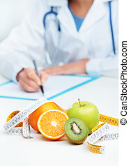 Nutritionist Doctor is writing a prescription. Focus on ...