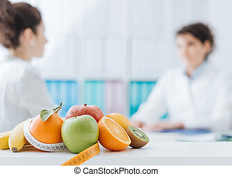 Nutritionist meeting a patient in the office - Professional ...