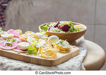 Nutritious cereal breads with cream cheese and salad.