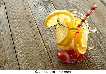 Nutritious detox water with lemon and raspberries