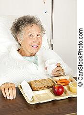 Nutritious Hospital Lunch - Senior woman in the hospital, ...