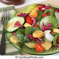 Nutritious Salad - Salad with baby spinach, cucumbers,...
