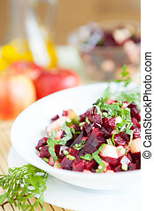 nutritious salad with beets in a white bowl
