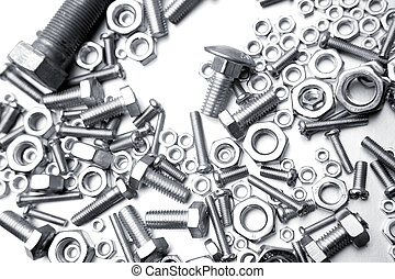 Nuts and bolts on white
