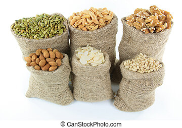 Nuts and seeds in burlap bags. - Still picture of burlap...