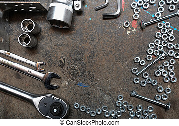 Nuts, bolts, wrenches on the old table metal