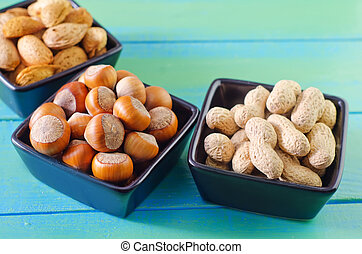nuts in black bowls