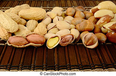 Nuts in line-peanuts, walnuts, pistachios, brasil nuts on ...