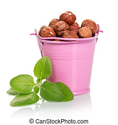 Nuts in pink bucket and mint isolated