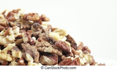 Nuts of Walnuts in bulk - Pile of pine nuts in bulk on a...