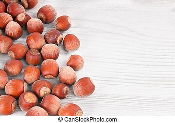 Nuts on a wooden board.