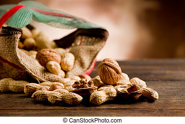 photo of differents nuts inside a cloth on wooden table