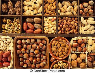 Varieties of nuts: peanuts, hazelnuts, chestnuts, walnuts, pistachio and others.